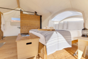 Under Canvas, Grand Canyon has a range of glamping tents, including the Stargazer tent pictured here