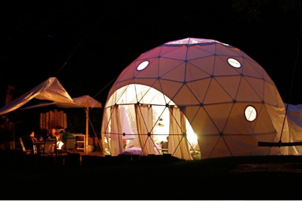 Glamping dome at night at the Dome Garden
